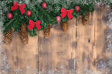 Decorated wooden background with Christmas tree branches