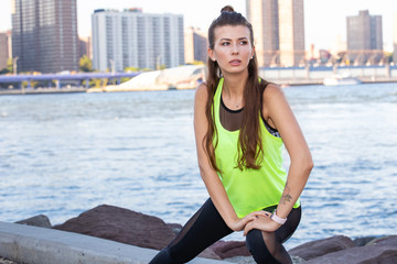 Healthy woman stretches outside before working out