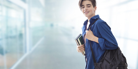 student with backpack and books at college or university