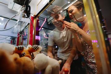 Man and woman having fun at a gaming arcade