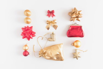 Christmas composition. Christmas golden and red decorations, pine cone, star, gift, balls on white background. Flat lay, top view, copy space