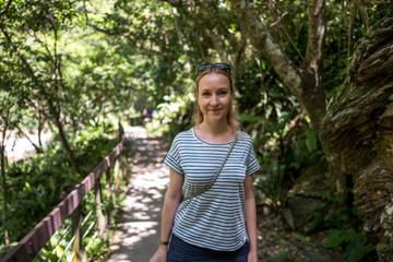 Caucasian girl at the Shakadang Trail at Taroko Gorge National Park in Taiwan