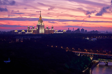 lluminated silhouette of famous Russian university on the dramatic background of dramatic sunset sky