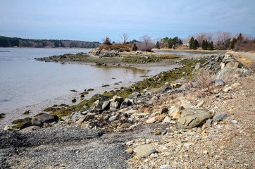 Rocky, scenic saltwater shoreline along the Atlantic Ocean at the Goat Island Saltwater Fishing Access area near Portsmouth, New Hampshire in the springtime.