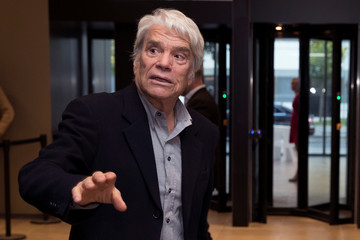 French businessman Bernard Tapie arrives to attend the inauguration of the Altice Campus in Paris