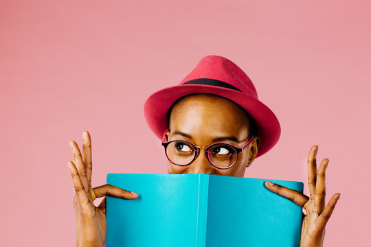 Studio shot of woman holding book