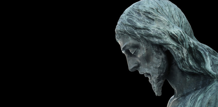 An ancient statue of the crucifixion of Jesus Christ in profile
