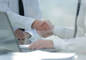 close up.handshake business people at the Desk