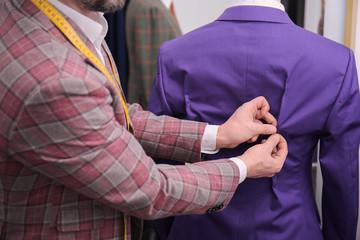 Tailor working in atelier, closeup