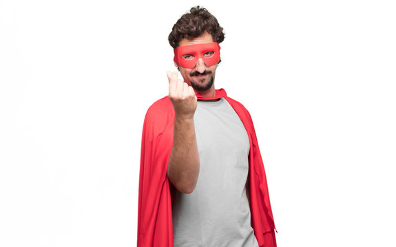 Young bearded super hero looking happy, proud and satisfied, gesturing cash or money, announcing profitable business with a symbol for currency or richness.