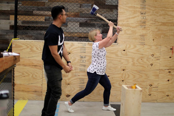 Leslie Parker participates in axe throwing, a sport that started in the Canadian backwoods and is growing in popularity in U.S. cities, at LA Ax in North Hollywood, Los Angeles