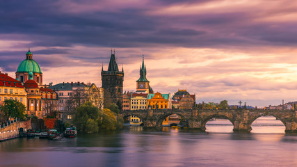 Scenic spring sunset aerial view of the Prague Old Town pier architecture and Charles Bridge over Vltava river in Prague, Czech Republic