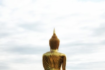 Backside of Gold Buddha statue and sky