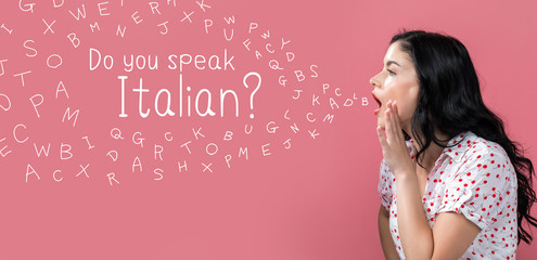 Do you speak Italian theme with young woman speaking on a pink background