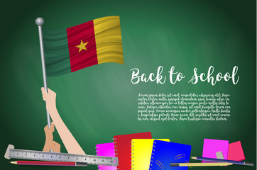 Vector flag of cameroon on Black chalkboard background. Education Background with Hands Holding Up of cameroon flag. Back to school with pencils, books