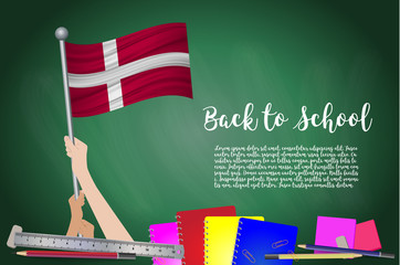Vector flag of denmark on Black chalkboard background. Education Background with Hands Holding Up of denmark flag. Back to school with pencils, books