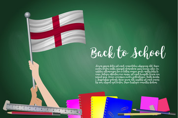Vector flag of England on Black chalkboard background. Education Background with Hands Holding Up of England flag. Back to school with pencils, books