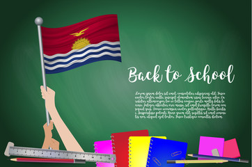 Vector flag of Kiribati on Black chalkboard background. Education Background with Hands Holding Up of Kiribati flag. Back to school with pencils, books