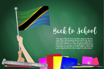 Vector flag of Tanzania on Black chalkboard background. Education Background with Hands Holding Up of Tanzania flag. Back to school with pencils, books, school items learning and childhood concept.