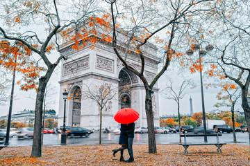 Couple in Paris under umbrella