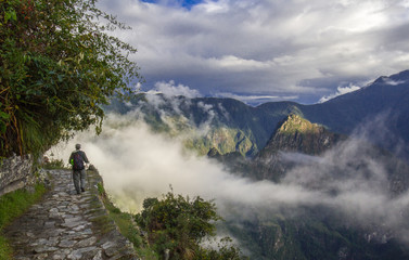 Blue cloudy sky above the ruins of Machu Picchu in Peru Wall mural