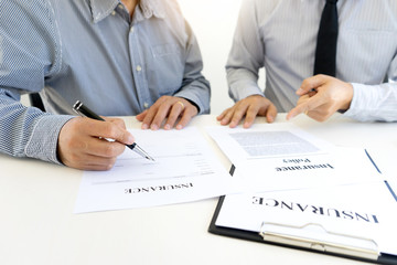 Young Business man insurance agent show document contract