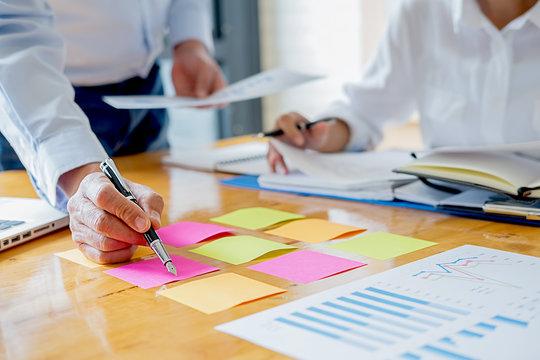 Business adviser analyzing financial figures denoting the progress Internal Revenue Service checking document. Audit concept