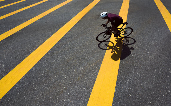 Asian man cycling road bike in the morning.top view
