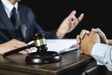 Meeting and collaboration concept, Businessman and Male lawyer or judge consult having team meeting with client discussing of contract in courtroom