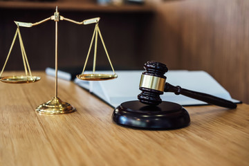 Scales of justice and Gavel on sounding block and law book to working with judge agreement in Courtroom, Justice and Law concept