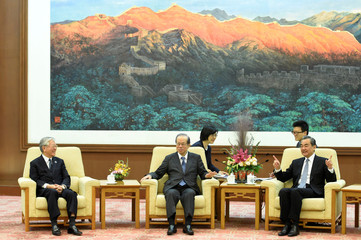 Hiroaki Nakanishi, chairman of Keidanren, Japan's former Prime Minister Yasuo Fukuda and Chinese State Councilor and Foreign Minister Wang Yi attend a meeting at the Great Hall of the People in Beijing