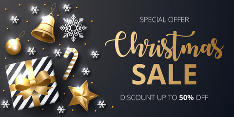 Christmas sale banner with shining gold and white ornaments.
