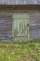Old house with green wooden door. Vintage background