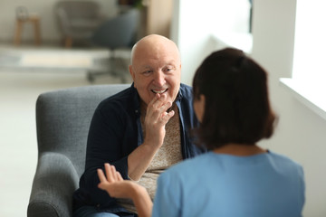 Fototapeta Young nurse visiting elderly woman at home obraz