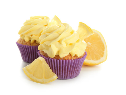 Delicious lemon cupcakes on white background