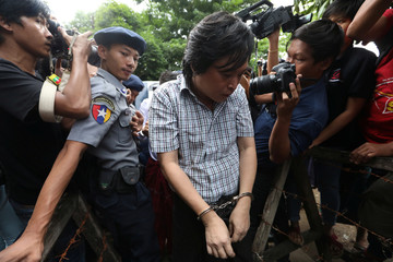 Nayi Min, an editor at Eleven Media arrives after being detained at Tamwe court in Yangon