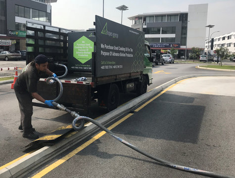 Malaysian waste oil collector FatHopes Energy collect used cooking oil from a fast food outlet in Shah Alam, outside Malaysia's capital city of Kuala Lumpur