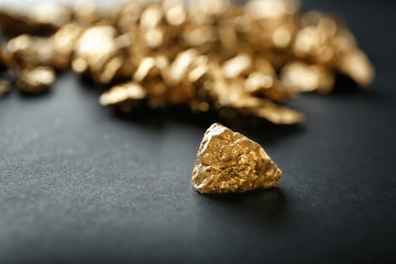 Gold nugget on black background
