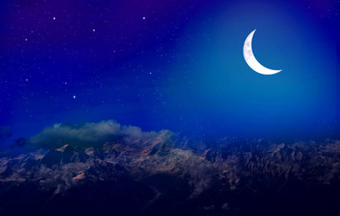New moon over snow peaks