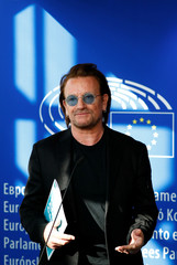 Bono, U2 singer and co-founder of the One campaign, meets with European Parliament President Antonio Tajani in Brussels