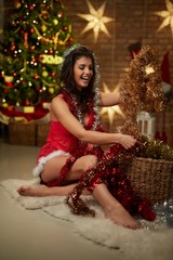 Woman in lingerie with Christmas tree