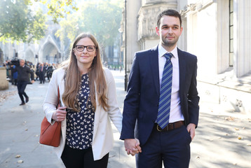 Daniel and Amy McArthur, who own Ashers Bakery in Belfast, leave the Supreme Court in London