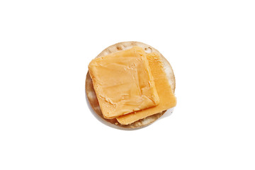 Isolated cheddar cheese slices and water cracker over a white background. Clipping path included.