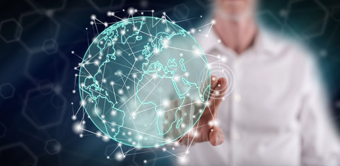 Man touching a global connection concept