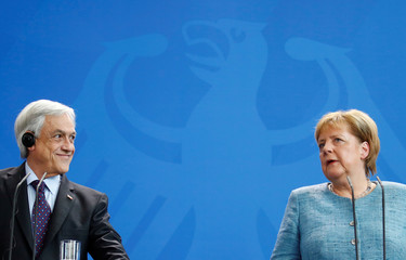 German Chancellor Angela Merkel talks during a news conference with Chilean President Sebastian Pinera in Berlin