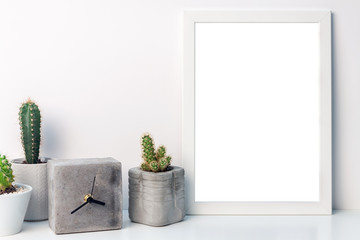 White mockup frame with cactuses and a concrete clock