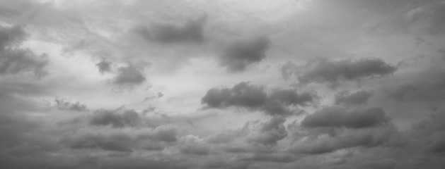 Panorama of beautiful thunder clouds. Grey overcast dramatic sky. Fotobehang