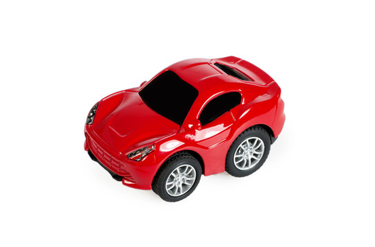 Red toy car on white