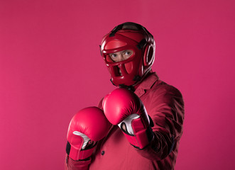 businessman in boxing gloves, a man in a red suit