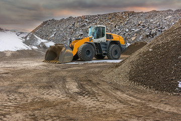 Excavator working in winter in a surface mine Wall mural